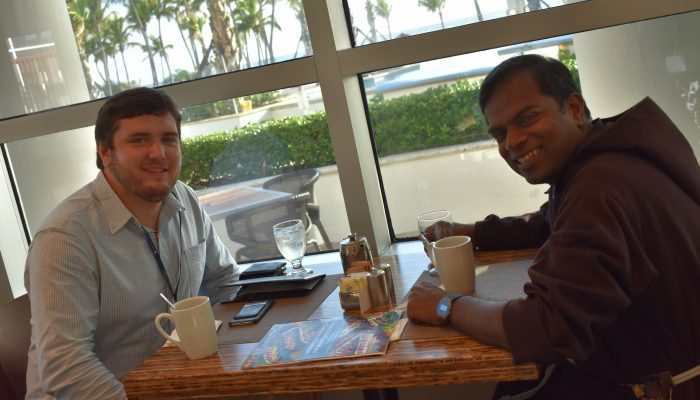 Graduate student scholar & international scholar exchange ideas at breakfast