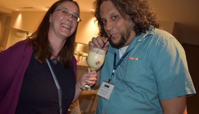 Registrant enjoys cool beverage at Opening Reception