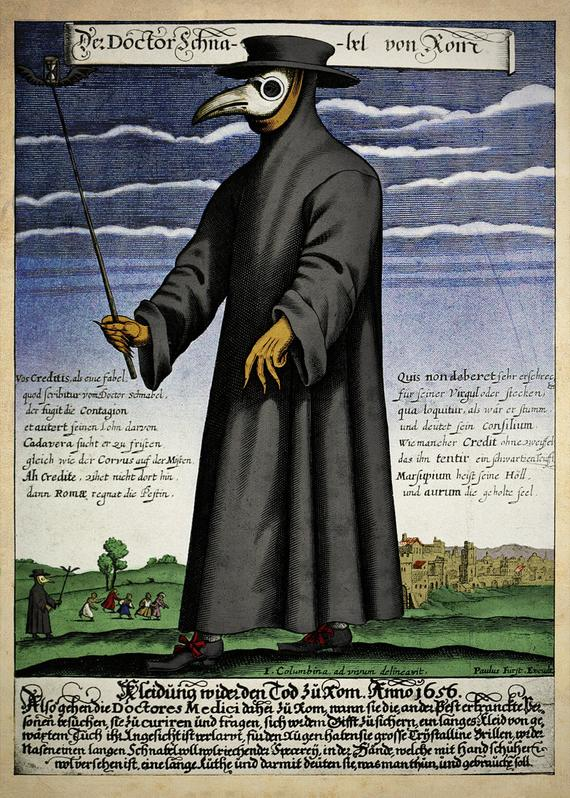Image of man in long black robe with beak-shaped mask